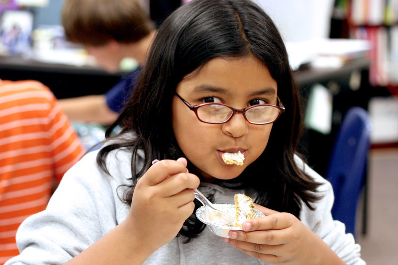 3/14 - today is Pi Day, and it always reminds me of Jackie. She loved to help me cook, and we made mini pies for her class's pi-day celebration when she was in 5th grade. She hates this picture of her eating one of our pies, but I love it so much, I hope she'll forgive me for posting it.