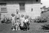 "138. The Nephews & Nieces. (GMJ: ""Up to that point and leaving out Darrell Moore's kids."")  L to R: Sheryl Simmons, Gordon Simmons with Steven Simmons in front, Linda Jean Moore, Douglas Moore, and Randall Craig Simmons. Rosewood Homes Housing Project. 1957"