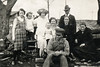 104. Moore Family (April 16, 1924?). Standing: Geneva Moore, Kenny King?, Evelena Moore nee Varnum, Reuben Moore. Seated: Dale Moore on Dallia Moore's knee, Ina King ?, Lydia Varnum. Front: Sherman Varnum