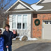 Connor and Grammi in front of Mike Duffy's house.