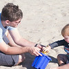 Declan and Wade play in the sand