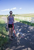 My daughter, Erica, walks her Weimaraner back to the ranch where we stay. Taken in Douglas County, Colorado, USA.