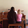 Keira playing duet with Kallie at Piano class.