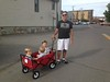 Boyz in red wagon with Dad
