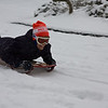 Aimee sledding down the hill!