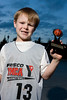 Jeb sports his basketball trophy.