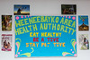 Weeneebayko Area Health Authority Eat Healthy Be Active Stay Positive sign at Fort Albany Hospital.