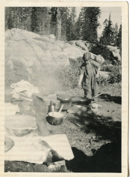 Bettie Whitney tending the fire   The girls stayed in camp to get ready to cook trout for the men  Faith Hope and Charity Valley trip  Patti and Bettie both wore red bandanas