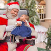 Kaili meets Santa for the first time.