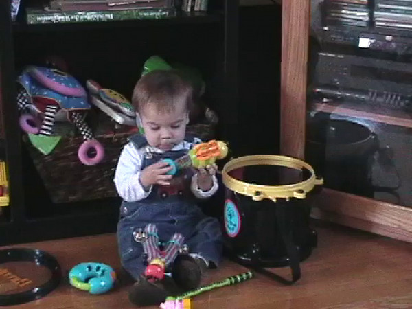 2003-2-13 - Ian taking out and putting back toys in drum, then watching Erda and Chewie outside