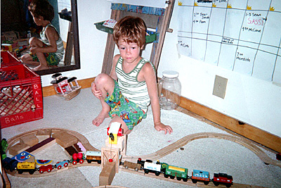 With Thomas the Tank Engine setup. It got much more elaborate than this, before he switched to electric trains.