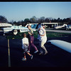Circa early 80s/ Cathy holding baby Laura before flying down to Bermuda in the family plane. Looks like Helen Moriarty, aka mom, is with her and little Lisa also.