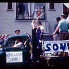 Depression era float in the Springfield parade. Notice the people watching from the window.