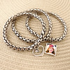 3 piece photo bracelet with heart. Double side photo charm, holds 2 photos. $40.00