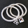 3 piece photo bracelet with butterfly. Double side photo charm, holds 2 photos. $40.00