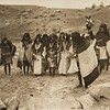 Offering sacred meal, Mishongnovi flute dance (The North American Indian, v. XII. Norwood, MA, The Plimpton Press, 1922)