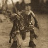 """A """"catcher"""" picking up a snake (The North American Indian, v. XII. Norwood, MA, The Plimpton Press, 1922)"""