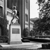 """The statue of """"Tommy Trojan"""" in front of Bovard Auditorium, University of Southern California, 1949"""