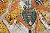 "[EGYPT 29344] 'Priests in Userhet's tomb at Luxor.'  	A Sem priest in a leopard skin holds a bouquet of flowers in a mural on one of the walls of Userhet's tomb. The two green bunches on the side of the bouquet are lettuce plants. Flowers played an important role in ancient Egyptian religion. They were a symbol for life and regeneration and when a bouquet had been in contact with the statue of a god it could transfer its godly essence. The two cartouches on the leopard skin belong to Seti I. Userhet (also called Neferhabef) was 'First Prophet of the Royal Ka (soul) of Thutmosis I' and served in the cult temple of this 18th dynasty pharaoh during the reigns of 19th dynasty pharaohs Ramses I and Seti I. His tomb (TT 51) is located in the Sheikh Abd el Qurnah Necropolis on the Westbank at Luxor and is one of the socalled ""Tombs of the Nobles"". Originally it was one of the most beautiful tombs of the necropolis, but it was badly vandalized in 1941, leaving most figures with chiseled out eyes. Photo Mick Palarczyk and Paul Smit."