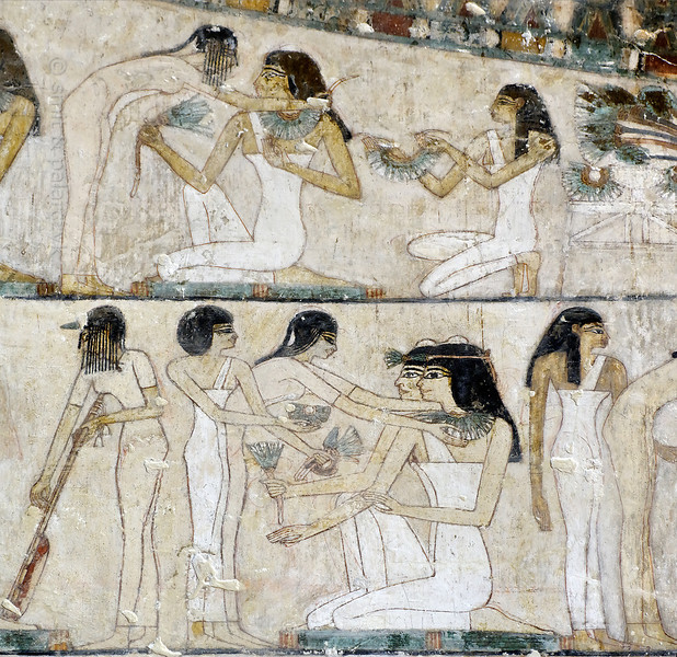 "[EGYPT 29353] 'Funeral banquet in Rekhmire's tomb at Luxor.'  	In Rekhmire's tomb a large painting in several registers shows his funeral banquet. Here we see a detail with servants offering lotus flowers and necklaces to female guests who are seated on mats. Rekhmire was an 18th dynasty vizier (viceroy) of Southern Egypt, mayor of Thebes and steward of the Amon Temple at Karnak during the reigns of Thutmosis III and Amenhotep II. His tomb (TT 100) is located in the Sheikh Abd el Qurnah Necropolis on the Westbank at Luxor and is one of the socalled ""Tombs of the Nobles"". Photo Mick Palarczyk and Paul Smit."