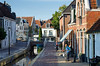 HOLLAND.FRIESLAND 30265] 'Cyclists in Dokkum'.