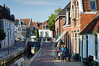 HOLLAND.FRIESLAND 30264] 'Cyclists in Dokkum'.