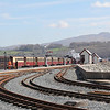 FFestiniog Railway Merdinn Emrys approaching Porthmadoc Station 1 passing Welsh Highland Railway stock Apr 14
