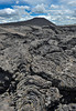 Pahoehoe, Jordan Craters, wih cinder cone in background.