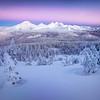 """<b>""""WINTER WONDERLAND""""</b>  Three Sisters Wilderness, Oregon  The first vestiges of pre-dawn light illuminate the Three Sisters in Central Oregon. The windchill was about -20F, but I was so excited at the scene before me that I shot for about 45 minutes without gloves because I didn't want to fudge a camera setting. Marc Adamus was standing right next to me laughing heartily in disbelief. He flourishes in the extreme cold, but even he thought I was overdoing it. I didn't care -- I live in Minnesota where -20F is called """"Thursday"""". :)"""