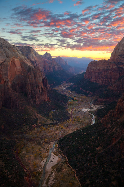 """ANGEL'S VIEW OF ZION""  Zion National Park, Utah  Seen from high above at sunset, magnificent Zion Canyon is truly a sight to behold. Look closely and you can see the Virgin River, the road, cars, and park buildings all nestled in place. Taken from the summit of Angel's Landing."
