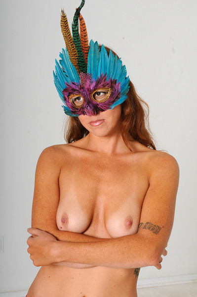 Masked nude beautiful girl in studio