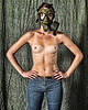 Topless nude studio portrait with Zombie gritty effect. And wearing gasmask.