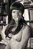Studio nude. Pretty girl wearing oxygen mask.