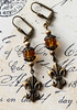 fleur de lis earrings in topaz and antiqued brass