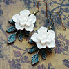 white flower earrings with green leaves