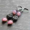 pink and black earrings fossil trilobite beads glass crystal