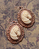 rosy copper horse cameo earrings