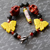 colorful handmade paper bead and lava bracelet