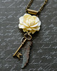 wings and key ivory rose vintage style necklace