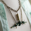 antiqued green patina brass prop plane airplane jet plane steampunk necklace travel themed fineanddandy