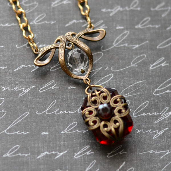 vintage style ruby red glass stone filigree bow necklace