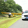 Small plane lands on Sunrise Hwy. in East Moriches/Eastport Friday July 17, 2014. The pilot of a small experimental single engine airplane made an emergency landing on Sunrise Hwy. just before exit 61 east bound around 13:00 hrs. Police sources said that it was the same gentleman who had made an emergency landing in the same area of Sunrise Hwy. last week on July 10, 2014. No injuries were reported.