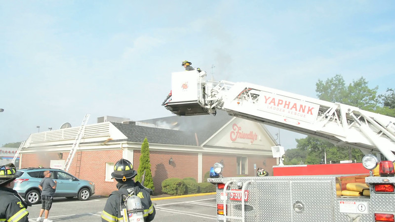 Fire at Friendly's restaurant in Medford Friday, August 1, 2014. Employees at the Friendly's restaurant in the Sunshine Square shopping mall called 9-1-1 at approx. 8:15 a.m. to report they had a fire, possibly caused by cooking oil, in their establishment on Sills Road (County Road 101/E. Patchogue-Yaphank Road). Upon fire dept. arrival, firefighters found the fire was located in the kitchen area with fire in the cockloft (attic space) of the commercial occupancy, with flames visible, at times, through the roof. Units from the Medford F.D. and Yaphank F.D. responded to the scene as well as SCPD and the fire marshals office. No injuries were reported at this time.
