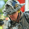A firefighter comes out for a much needed break with insulation all over him.<br /> <br /> Photo Scott LaPrade
