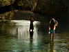 Cooling their heels. Two swimmers ponder a plunge into the river. Photo: Jill Heinerth