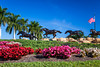 Horses, flowers and the American flag at the enrance to the Lely Resort at Naples, Florida, USA.