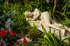 An Oriental Mummy sculpture lying in the garden in front of the Semmler Gallery in Naples, Florida, USA.