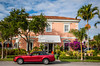 A red mustang car parked on the street in front of an Amano shop in Naples, Florida, USA.