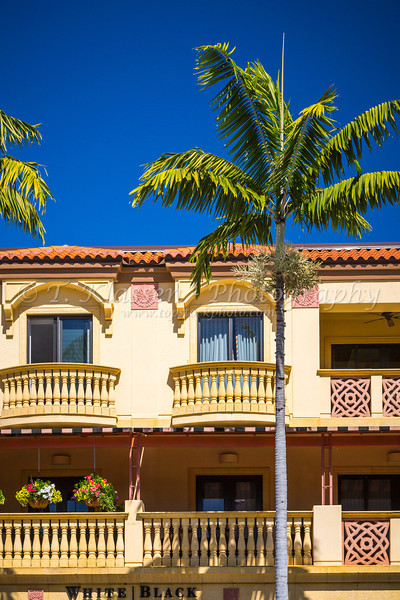 Spanish architecture with palm trees on 5th Ave. in Naples, Florida, USA.