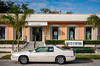 A white Cadillac parked in front of a ladies dress shop in Naples, Florida, USA.
